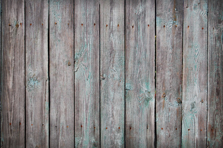 Photo pour Wooden Palisade background. Close up of grey and green wooden fence panels. - image libre de droit