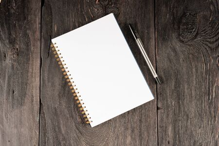 Photo for blank sheet in notebook for notes on a wooden table as a business concept. - Royalty Free Image