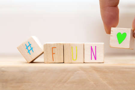 Photo pour Wooden cubes with hashtag and the word Fun in various colors, social media concept background close-up - image libre de droit