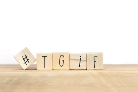 Photo pour Wooden cubes with Hashtag and the word tgif, meaning Thank god its Friday, social media concept background close-up - image libre de droit