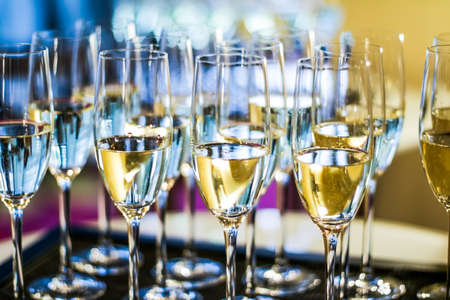 Photo pour Drinks, celebration and luxury concept - Glasses of champagne and sparkling wine served on a tray during charity event - image libre de droit