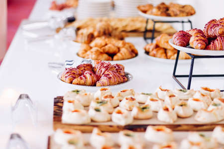 Photo pour Pastry buffet served at charity event, sweet food and dessert table setting - image libre de droit