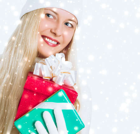 Photo for Happy woman holding Christmas gifts, silver background and snow glitter with copyspace, shopping and holidays - Royalty Free Image
