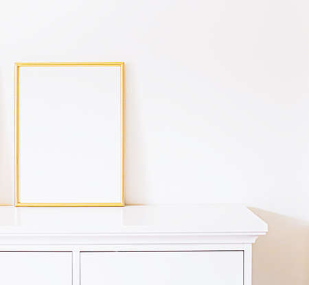 Photo pour Golden frame on white furniture, luxury home decor and design for mockup, poster print and printable art, online shop showcase - image libre de droit