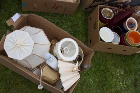 Boxes with lamps and other junk put out for an auction