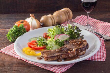 Kurobuta pork chop steak and vegetable on wooden table