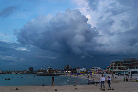 Jeju Island, South Korea, september 05, 2019: people at Hyeopjae Beach in the evening before storm with amazing cloudscape above themのeditorial素材
