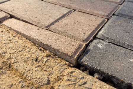 Uneven and poorly laid block paving