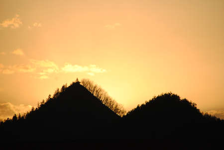 Silhouettes of hills in valley on sunset  Pothamedu