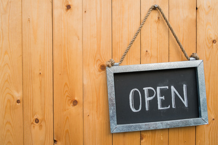 Photo pour Open Sign Hang On Wood Door - image libre de droit