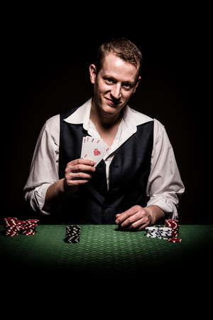 A male gambler makes four aces and winning hand