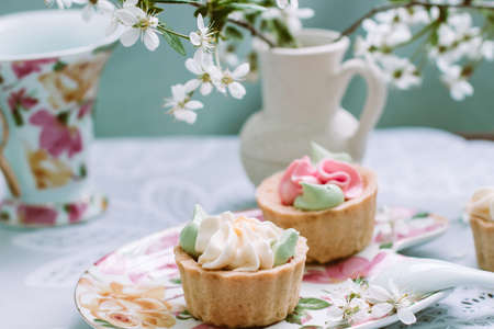cake on the background of the cherry blossoms