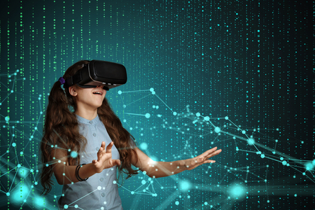 Photo pour Young girl using virtual reality glasses. Future technology concept. - image libre de droit