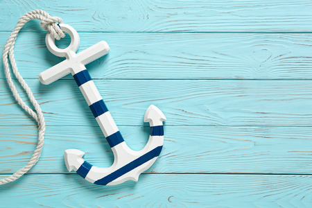 Photo for Anchor on a blue vintage wooden background. - Royalty Free Image