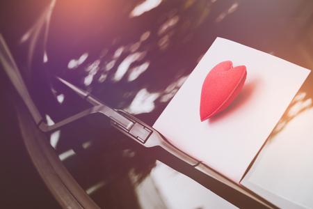 Foto de love letter heart on a sticky note under a windshield .vintage  color style - Imagen libre de derechos