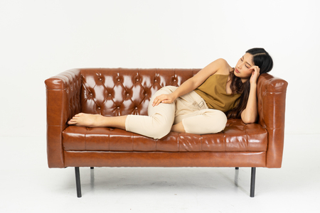 Foto de home, leisure, technology and happiness concept - smiling teenage girl sitting on sofa with tablet .office synonym concept. - Imagen libre de derechos