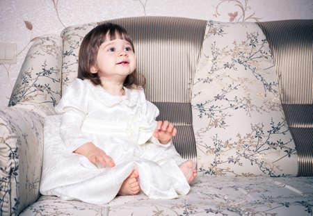 Photo pour Baby dressed in white dress - image libre de droit