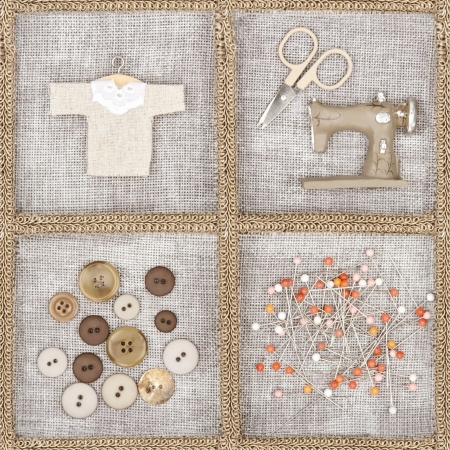 Sewing items - scissors, sewing machine, buttons, shirt - on rustic linen background