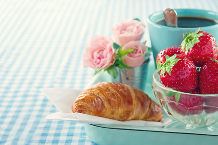 Breakfast in bed - mother's day tray with food and flowers