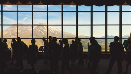 Photo pour Washington state, USA - June 24, 2018: People near the window with a view of Mount St. Helens in the Johnston Ridge Observatory - image libre de droit