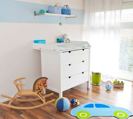 Modern children's playroom with changing table