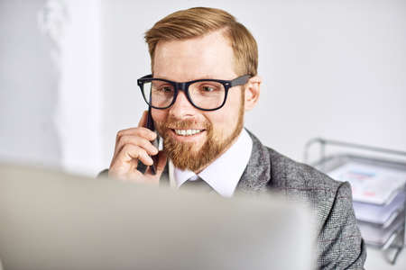 Photo for Mid age businessman working on computer at the office - Royalty Free Image