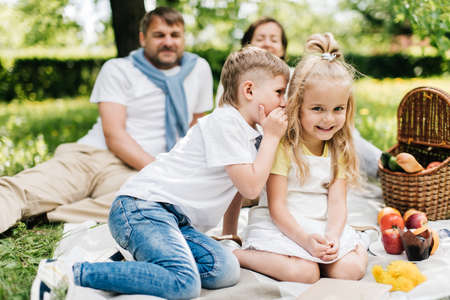 Photo for Little brother telling secrects to his sister. - Royalty Free Image