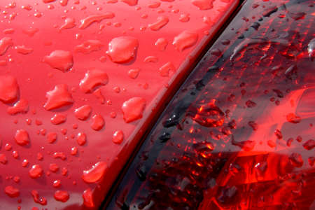 Detail of drops on a red car
