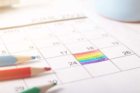 Photo pour June 25, 2021 is rainbow flag day. painted in calendar the symbolic colors of the flag. - image libre de droit