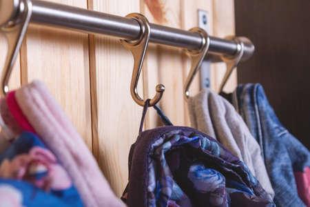 Photo pour Kids cloth hanginig on metal hooks. Close-up. - image libre de droit