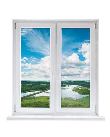 Foto de White plastic double door window with view to tranquil landscape - Imagen libre de derechos