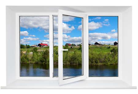 Foto de White plastic triple door window with trunquil view through glass  Isolated on white background  Opened door - Imagen libre de derechos