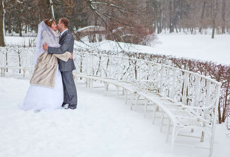 Young Wedding Caucasian Russian Couple Kissing In Snowy Park Winter
