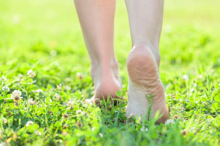 Light step barefoot on the soft summer grass