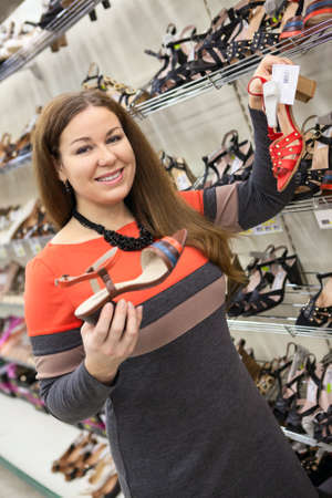 Attractive woman buying shoes in the shopping center