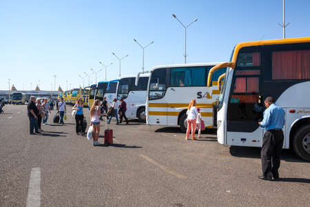 HURGHADA, EGYPT - CIRCA NOV, 2015: Line from the passenger buses for tourists local transfer to hotels is in the Hurghada International airport