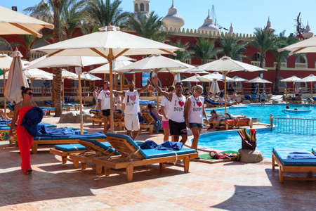 HURGHADA, EGYPT - CIRCA NOV, 2015: Recreational multiethnic animation team makes fun in hotel area. The Alf Leila Wa Leila spa (1001 Nights) is one of the Pickalbatros chain spas in Hurgada resort