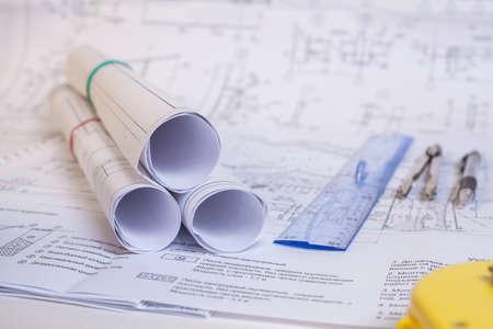 Foto de Design documentation is on the table. Tool for designers. Rolls of drawings. - Imagen libre de derechos