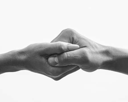 Photo for Female hand intertwined with a male hand - Royalty Free Image