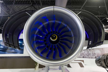 Jet engine with opened hood, turbine blades of modern passenger plane, aircraft concept, aviation and aerospace industry