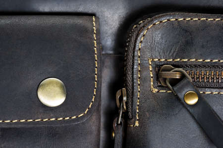 Photo pour Leather bag with zipper, magnetic clasp on pocket and stitches, man accessories in vintage style, macro shot, selective focus - image libre de droit