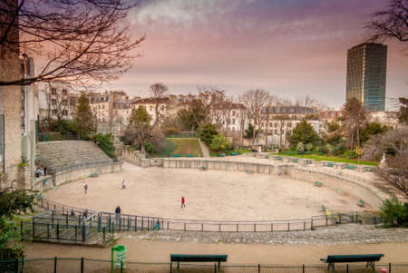 Winter in Paris inside the beautiful Latin Quarter and its Arenes de Lutece is nice when children play football when some century before, gladiators were fighting till death !