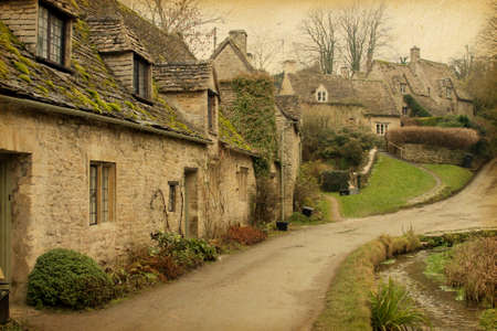 Bibury Traditional Cotswold cottages in England, UK  Photo in retro style  Paper texture