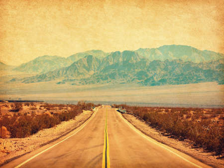 Photo pour Route 66 crossing the Mojave Desert, California, United States.  Photo in retro style. Added paper texture. Toned image - image libre de droit