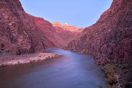 Long exposure of Grand Canyon and Colorado River lit with twilight.