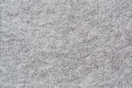 Horizontal background of soft grey felt with genuine texture
