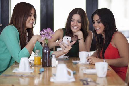 Beautiful female friends having fun at a restaurant