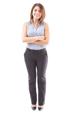 Full length view of a gorgeous school teacher with arms crossed against a white background