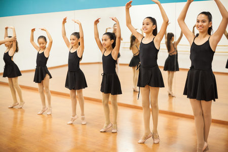 Group of girls practicing some ballet in a dance class at school