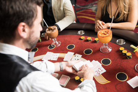 Photo pour Point of view of a card dealer at work in a blackjack table in a casino - image libre de droit